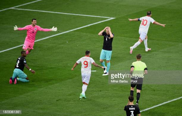 David Alaba of Austria looks dejected as Goran Pandev of North Macedonia celebrates scoring their side's first goal during the UEFA Euro 2020...