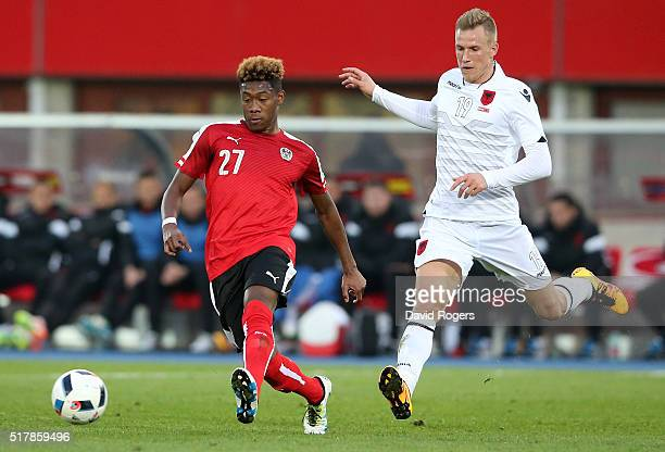 David Alaba of Austria moves away from Bekim Balaj during the international friendly match between Austria and Albania at the Ernst Happel Stadium on...