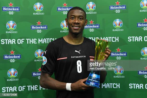 """David Alaba of Austria poses for a photograph with their Heineken """"Star of the Match"""" award after the UEFA Euro 2020 Championship Group C match..."""