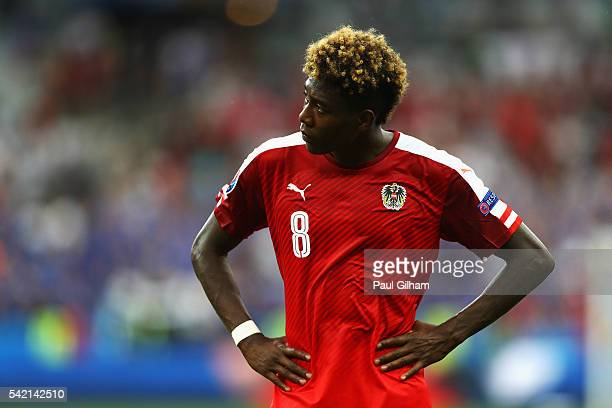 David Alaba of Austria shows his dejection after defeat in the UEFA EURO 2016 Group F match between Iceland and Austria at Stade de France on June 22...