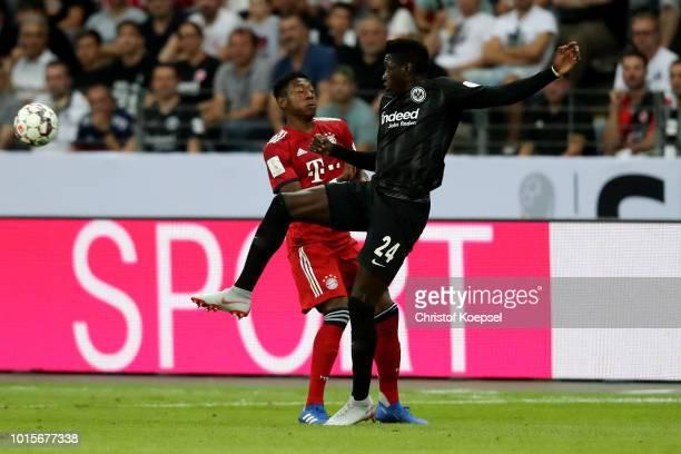 David Alaba of Bayern and Danny da Costa of Frankfurt go up for a header during the DFL Supercup match between Eintracht Frankfurt an Bayern Muenchen...