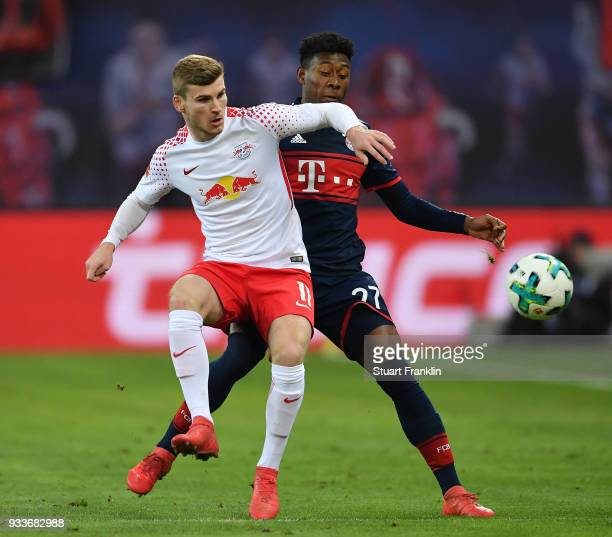 David Alaba of Bayern is challenged by Timo Werner of Leipzig during the Bundesliga match between RB Leipzig and FC Bayern Muenchen at Red Bull Arena...