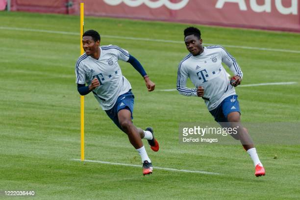 David Alaba of Bayern Muenchen and Alphonso Davies of Bayern Muenchen in Action during the FC Bayern Muenchen Training Session on April 30 2020 in...