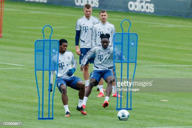 David Alaba of Bayern Muenchen and Alphonso Davies of Bayern Muenchen controls the ball during the FC Bayern Muenchen Training Session on May 05 2020...