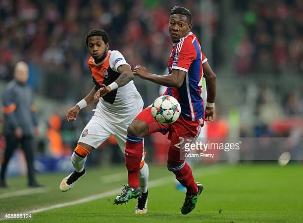 David Alaba of Bayern Muenchen and Fred of Shakhtar Donetsk chase the ball during the UEFA Champions League Round of 16 second leg match between FC...