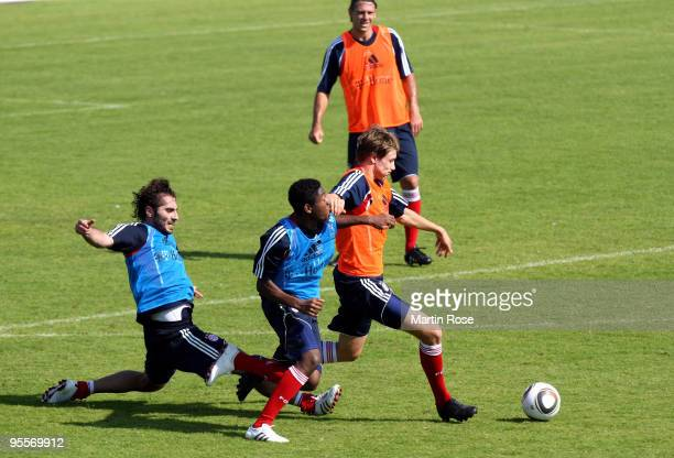David Alaba of Bayern Muenchen and Holger Badstuber battle for the ball during the FC Bayern Muenchen training session at the Al Nasr training ground...