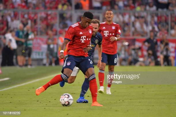 David Alaba of Bayern Muenchen and Juan Mata of Manchester United battle for the ball during the friendly match between Bayern Muenchen and...