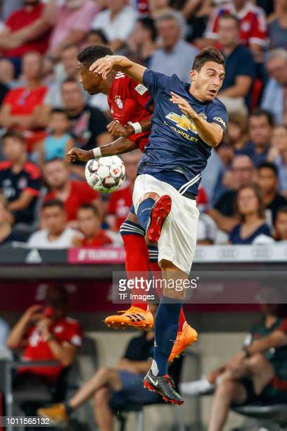 David Alaba of Bayern Muenchen and Matteo Darmian of Manchester United battle for the ball during the friendly match between Bayern Muenchen and...