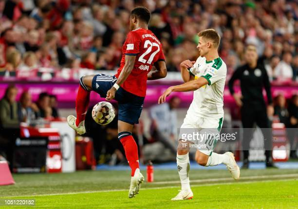 David Alaba of Bayern Muenchen and Thorgan Hazard of Borussia Moenchengladbach battle for the ball during the Bundesliga match between FC Bayern...