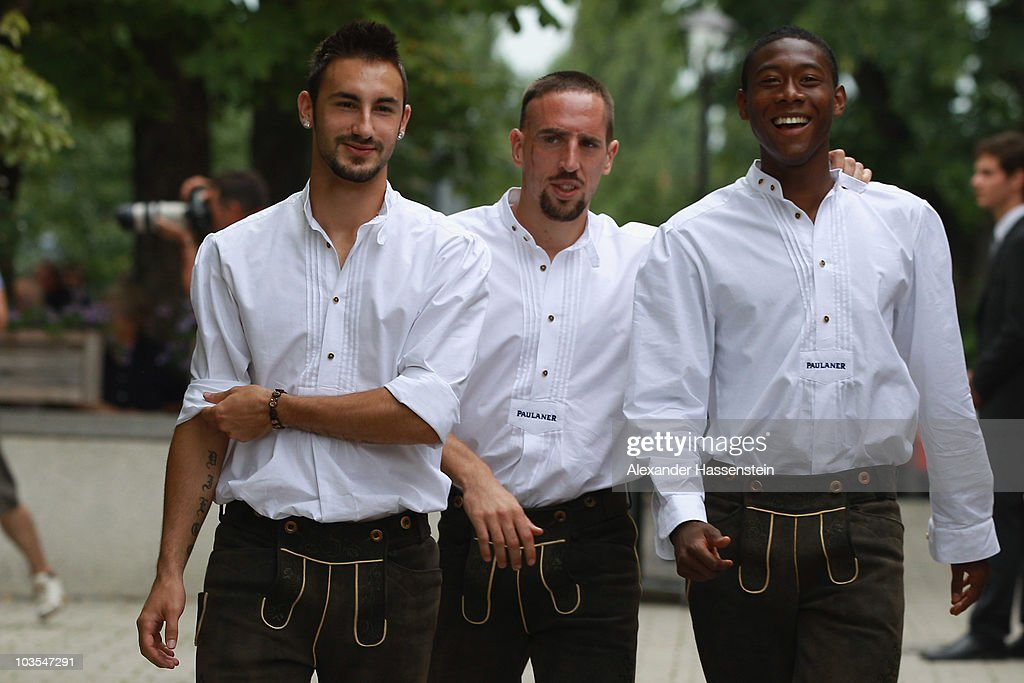 David Alaba (L) of Bayern Muenchen arrives with his team mates Franck Ribery (C) and Diego Contento (R) for the Paulaner photocall at the Nockerberg Biergarden on August 23, 2010 in Munich, Germany.