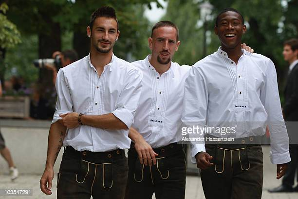 David Alaba of Bayern Muenchen arrives with his team mates Franck Ribery and Diego Contento for the Paulaner photocall at the Nockerberg Biergarden...