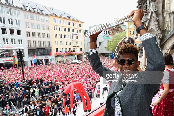 David Alaba of Bayern Muenchen celebrate winning the German Championship title on the town hall balcony at Marienplatz on May 15 2016 in Munich...