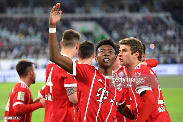 David Alaba of Bayern Muenchen celebrates after Robert Lewandowski of Bayern Muenchen scored a goal to make it 12 during the Bundesliga match between...