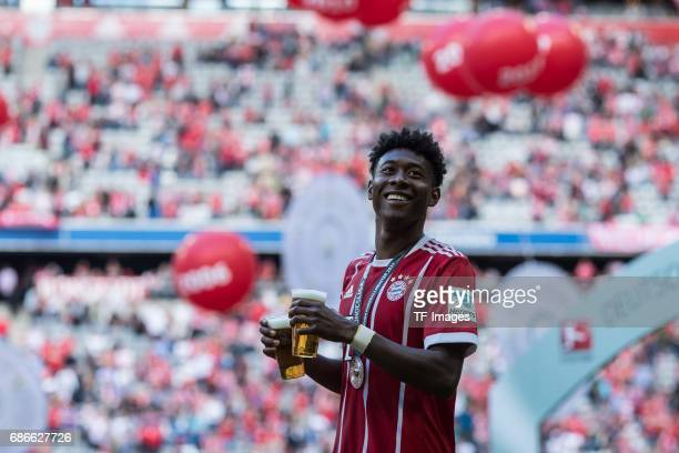 David Alaba of Bayern Muenchen celebrates with beer after the Bundesliga match between Bayern Muenchen and SC Freiburg at Allianz Arena on May 20...