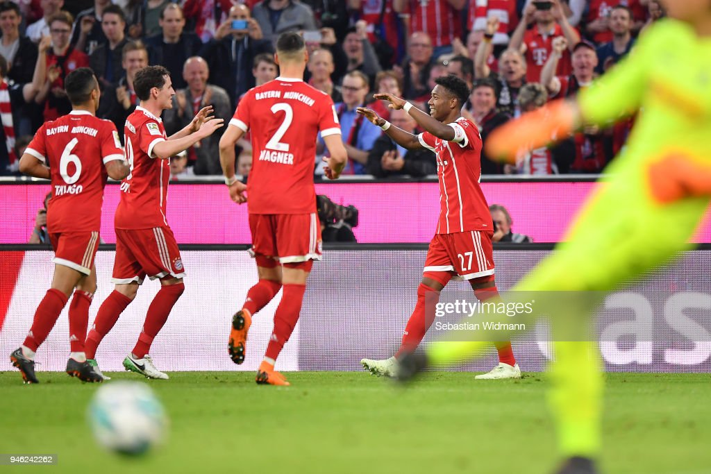 David Alaba of Bayern Muenchen (r) celebrates with his team after he scored a goal to make it 4:1 during the Bundesliga match between FC Bayern Muenchen and Borussia Moenchengladbach at Allianz Arena on April 14, 2018 in Munich, Germany.