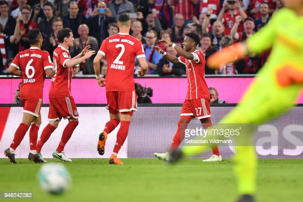 David Alaba of Bayern Muenchen celebrates with his team after he scored a goal to make it 41 during the Bundesliga match between FC Bayern Muenchen...
