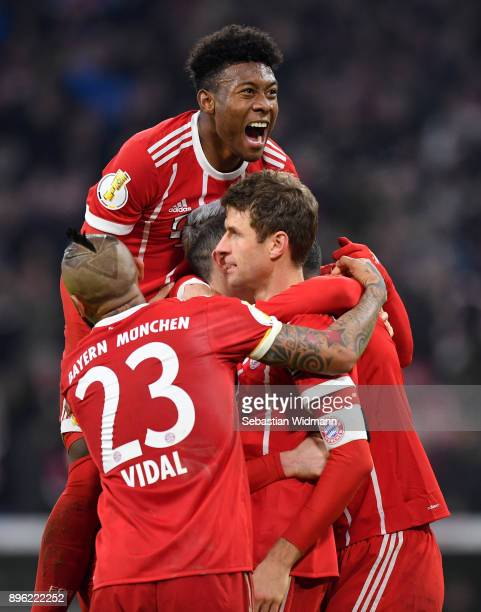 David Alaba of Bayern Muenchen celebrates with his team mates after Thomas Mueller of Bayern Muenchen scores his sides second goal of the game during...