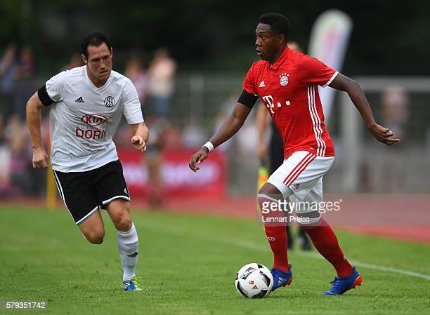 David Alaba of Bayern Muenchen challenges Christoph Hoesl of SpVgg Landshut during the preseason friendly match between SpVgg Landshut and FC Bayern...