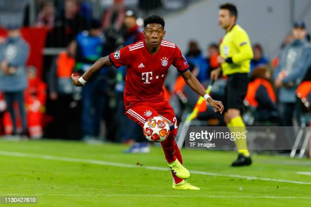 David Alaba of Bayern Muenchen controls the ball during the UEFA Champions League Round of 16 Second Leg match between FC Bayern Muenchen and...
