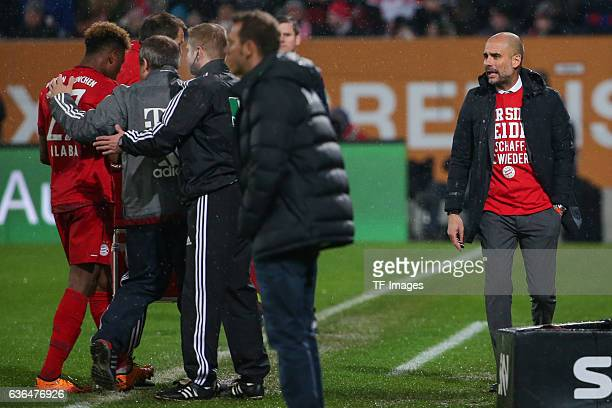 David Alaba of Bayern Muenchen Doctor Dr Volker Braun of Bayern Muenchen and Coach Josep Guardiola of Bayern Muenchen looks on during the Bundesliga...