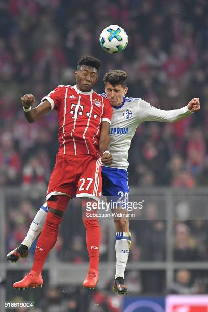 David Alaba of Bayern Muenchen fights for the ball with Alessandro Schoepf of Schalke during the Bundesliga match between FC Bayern Muenchen and FC...