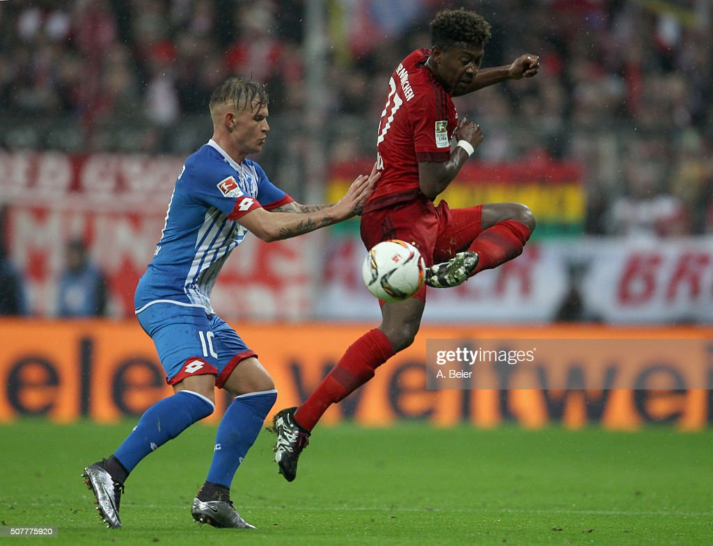 David Alaba (R) of Bayern Muenchen fights for the ball with Jonathan Schmid of Hoffenheim during the Bundesliga match between FC Bayern Muenchen and 1899 Hoffenheim at Allianz Arena on January 31, 2016 in Munich, Germany.