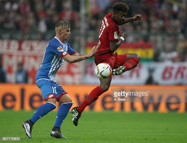 David Alaba of Bayern Muenchen fights for the ball with Jonathan Schmid of Hoffenheim during the Bundesliga match between FC Bayern Muenchen and 1899...