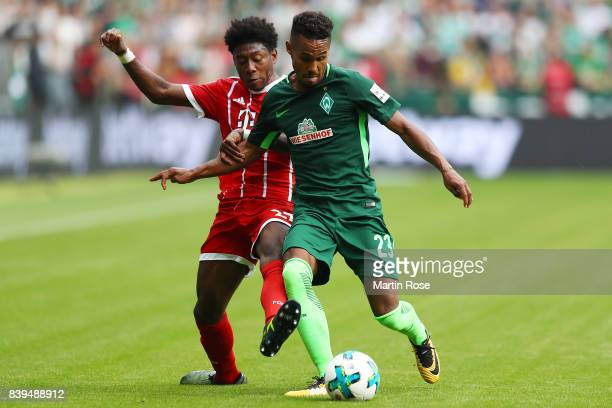 David Alaba of Bayern Muenchen fights for the ball with Theodor Gebre Selassie of Bremen during the Bundesliga match between SV Werder Bremen and FC...