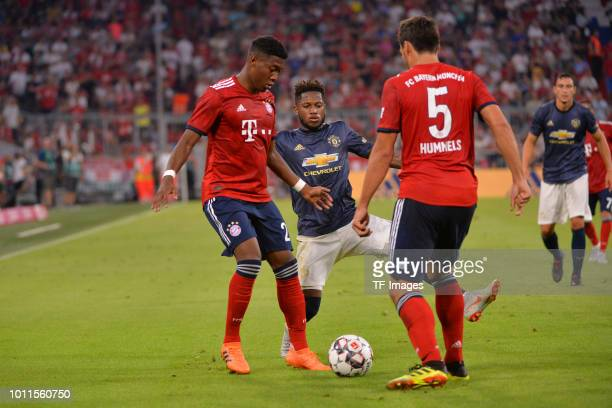 David Alaba of Bayern Muenchen Fred of Manchester United and Mats Hummels of Bayern Muenchen battle for the ball during the friendly match between...