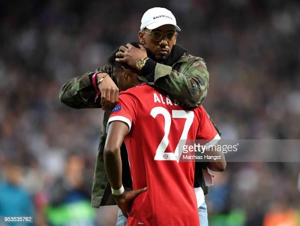 David Alaba of Bayern Muenchen is consoled by Jerome Boateng of Bayern Muenchen as they fail to reach the final after the UEFA Champions League Semi...
