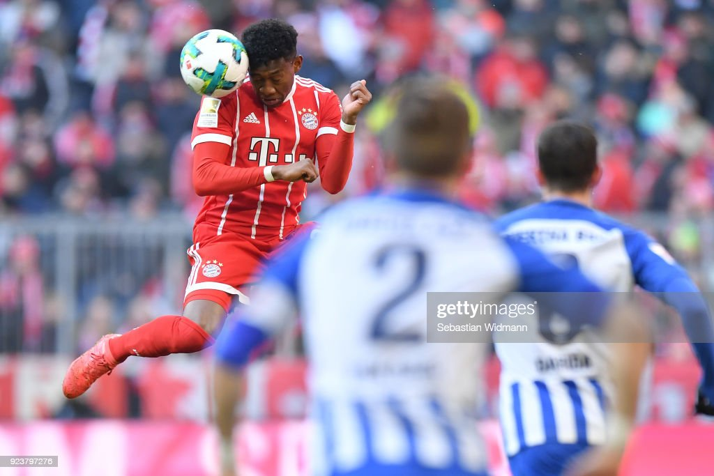 David Alaba of Bayern Muenchen jumps for a header during the Bundesliga match between FC Bayern Muenchen and Hertha BSC at Allianz Arena on February 24, 2018 in Munich, Germany.