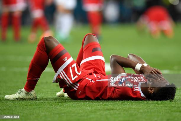 David Alaba of Bayern Muenchen looks dejected as they fail to reach the final after the UEFA Champions League Semi Final Second Leg match between...