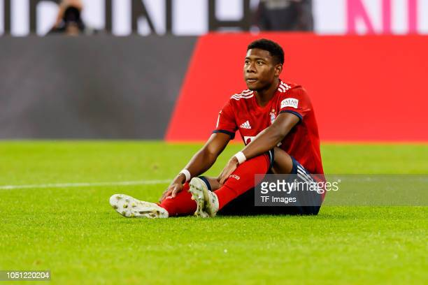David Alaba of Bayern Muenchen on the ground during the Bundesliga match between FC Bayern Muenchen and Borussia Moenchengladbach at Allianz Arena on...