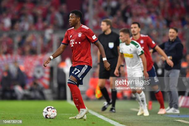 David Alaba of Bayern Muenchen plays the ball during the Bundesliga match between FC Bayern Muenchen and Borussia Moenchengladbach at Allianz Arena...