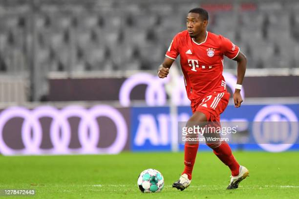 David Alaba of Bayern Muenchen plays the ball during the Bundesliga match between FC Bayern Muenchen and Hertha BSC at Allianz Arena on October 04,...