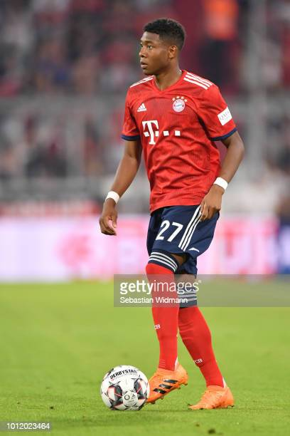 David Alaba of Bayern Muenchen plays the ball during the friendly match between Bayern Muenchen and Manchester United at Allianz Arena on August 5...