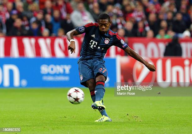 David Alaba of Bayern Muenchen scores their first goal from a free kick during the UEFA Champions League Group D match between Bayern Muenchen and...