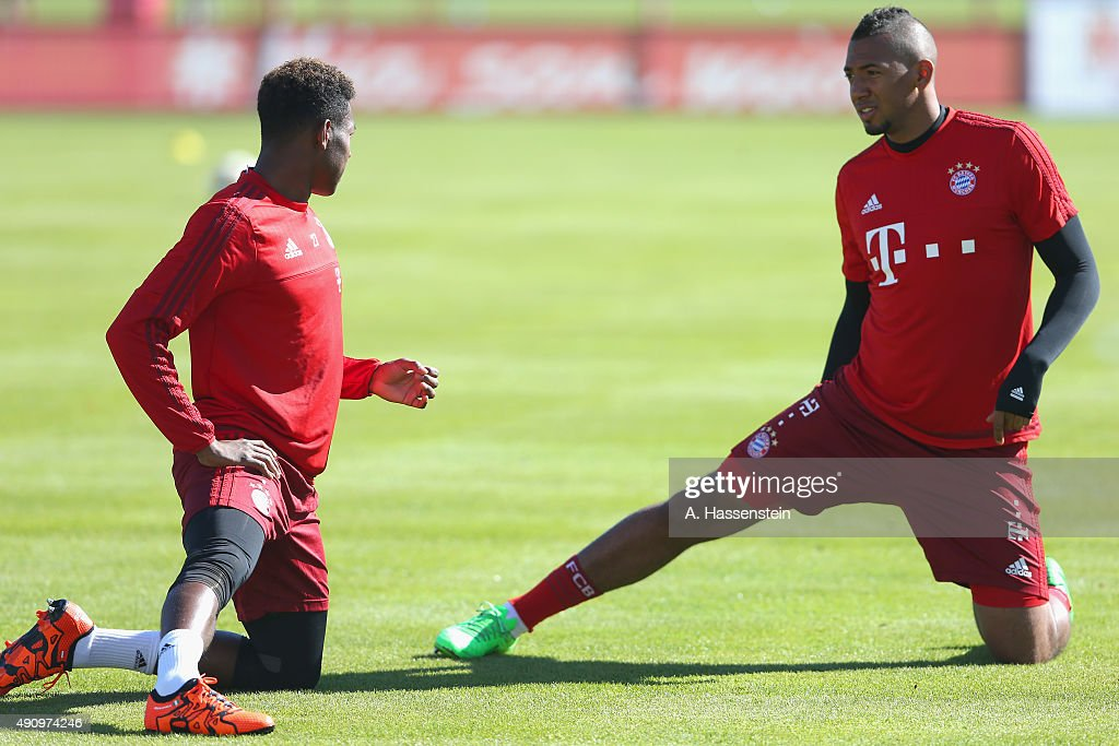 David Alaba (L) of Bayern Muenchen talks to his team mate Jerome Boateng during a training session at Bayern Muenchen's trainings ground Saebener Strasse on October 2, 2015 in Munich, Germany.