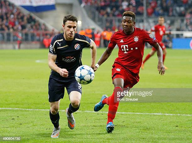 David Alaba of Bayern Munchen challenges Angelo Henriquez of Dinamo Zagreb during the UEFA Champions League Group F match between FC Bayern Munchen...