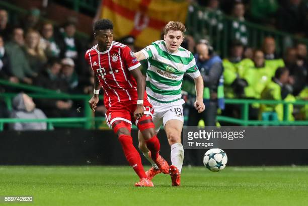 David Alaba of Bayern Munich and James Forrest of Celtic battle for the ball during the UEFA Champions League group B match between Celtic FC and...