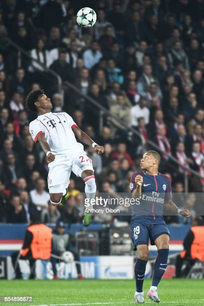 David Alaba of Bayern Munich and Kylian Mbappe of PSG during the Uefa Champions League match between Paris Saint Germain and Fc Bayern Muenchen on...