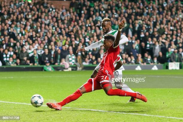 David Alaba of Bayern Munich and Moussa Dembele of Celtic battle for the ball during the UEFA Champions League group B match between Celtic FC and...