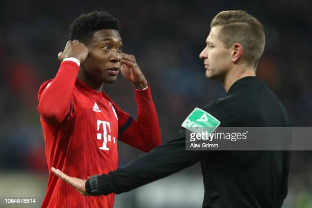David Alaba of Bayern Munich argues with the referee during the Bundesliga match between TSG 1899 Hoffenheim and FC Bayern Muenchen at Wirsol...