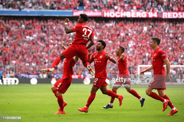 David Alaba of Bayern Munich celebrates after scoring his team's second goal during the Bundesliga match between FC Bayern Muenchen and Eintracht...