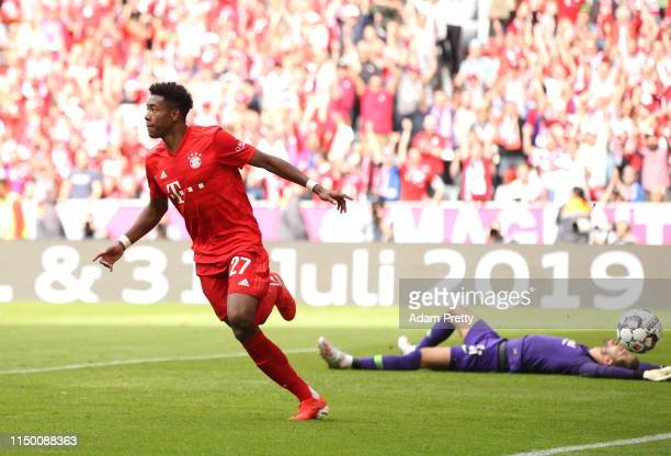 David Alaba of Bayern Munich celebrates after scoring his team's second goal as Kevin Trapp of Eintracht Frankfurt reacts during the Bundesliga match...