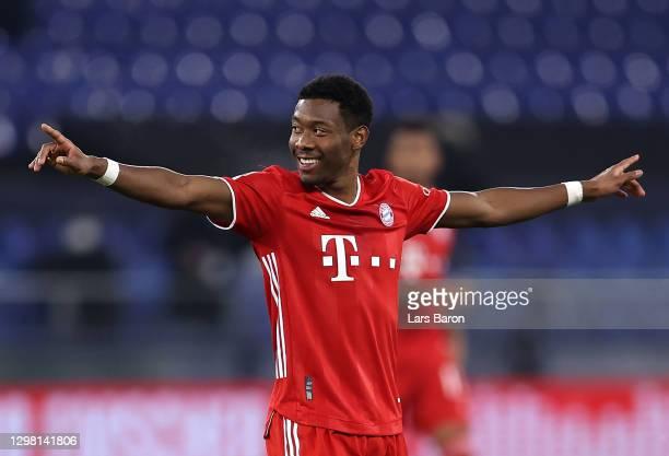 David Alaba of Bayern Munich celebrates after scoring their sides fourth goal during the Bundesliga match between FC Schalke 04 and FC Bayern...
