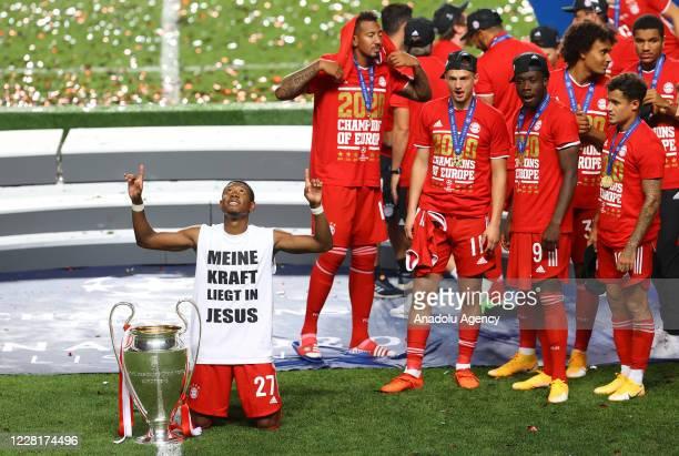 David Alaba of Bayern Munich celebrates at the end of the UEFA Champions League final football match between Paris SaintGermain and Bayern Munich at...