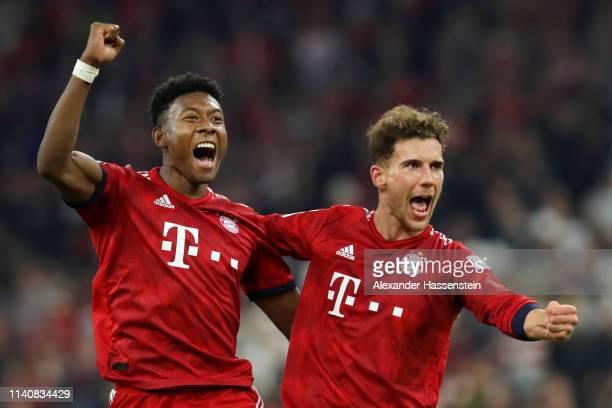David Alaba of Bayern Munich celebrates victory with Leon Goretzka of Bayern Munich after the Bundesliga match between FC Bayern Muenchen and...