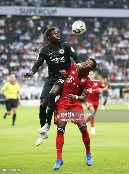 David Alaba of Bayern Munich challenges Danny da Costa of Eintracht Frankfurt during the DFL Supercup 2018 match between Eintracht Frankfurt and...