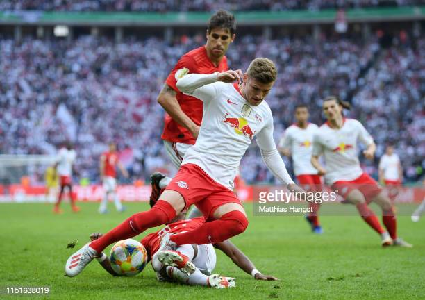David Alaba of Bayern Munich challenges Timo Werner of RB Leipzig during the DFB Cup final between RB Leipzig and Bayern Muenchen at Olympiastadion...